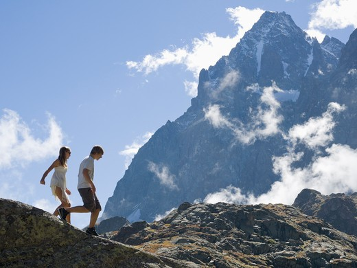 Italy, Piedmont, Teenage kids walking along mountain ridge : Stock Photo
