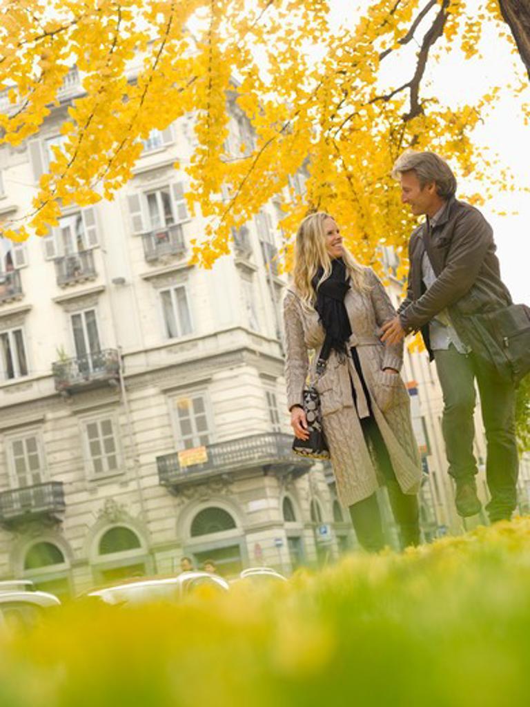 Italy, Piedmont, Turin, Couple walking under autumn leaves : Stock Photo