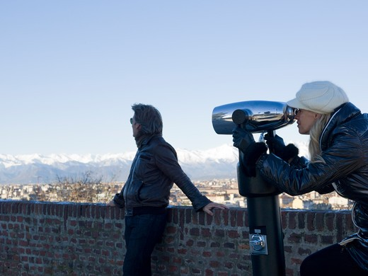 Stock Photo: 1315R-10472 Italy, Piedmont, Turin, Couple looking through spotting telescope