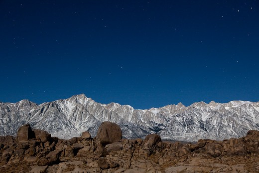 Low angle view of mountains in moonlight at night, Alabama Hills, Lone Pine Peak, Mt Whitney, Californian Sierra Nevada, California, USA : Stock Photo