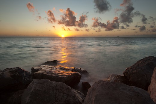 Stock Photo: 1317-1319 USA, Florida, Key West, Rocky shoreline during sunset