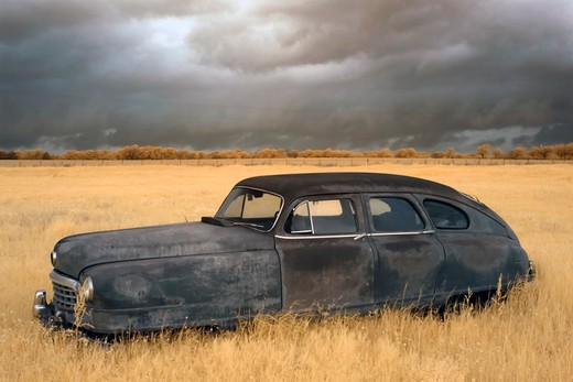 Stock Photo: 1317-1433 Old car rusting away in a field