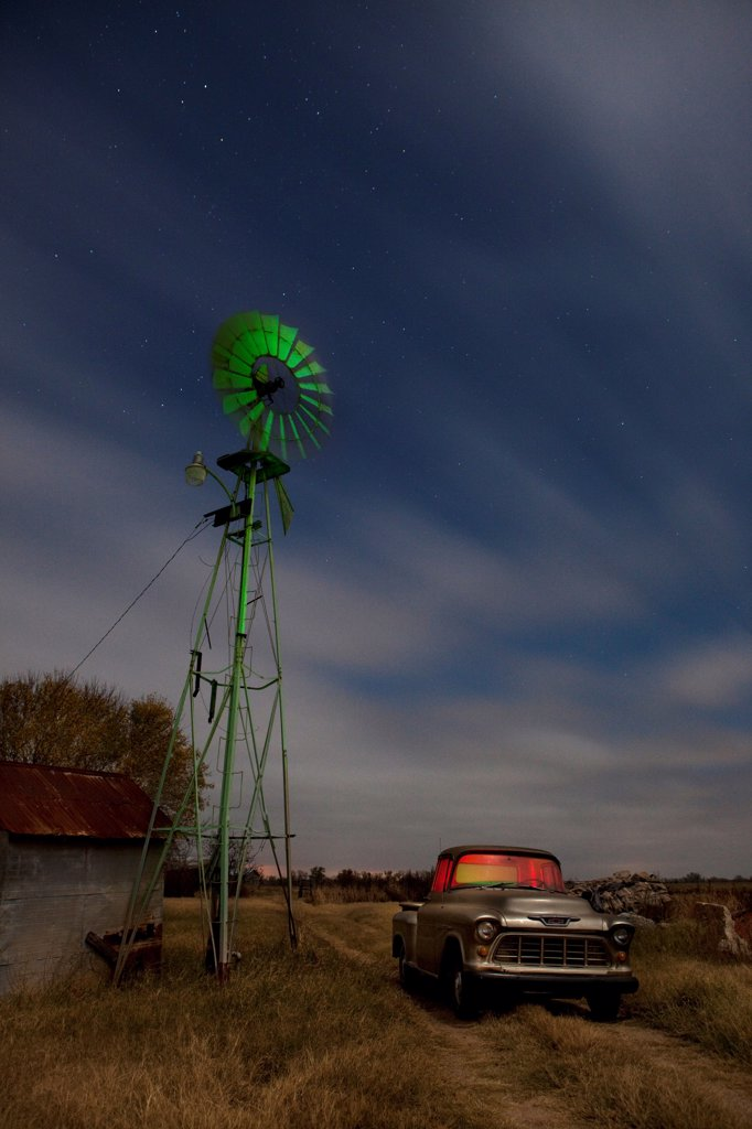 Stock Photo: 1317-1603 USA, Texas, Old Farm Truck and Windmill on farm
