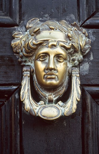 Close-up of a door knocker : Stock Photo