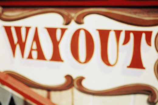 Close-up of a sign with the word wayout : Stock Photo