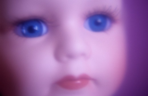 Stock Photo: 1318-1431 Close-up of face of modern baby doll in cool daylight