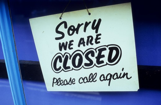 Stock Photo: 1318-1557 Detail of a shop door with sign stating Sorry We Are Closed Please Call Again, Suffolk, England