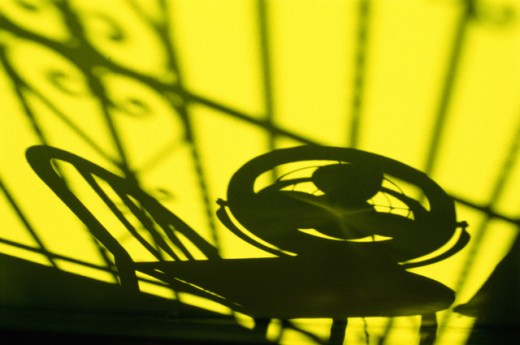 Silhouette of an electric fan on a chair : Stock Photo