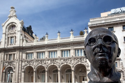 Low angle view of a statue in front of a building, Madrid, Spain : Stock Photo