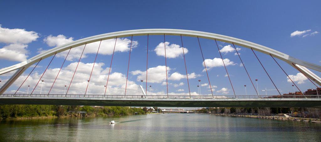 Suspension bridge across a river, Barqueta Bridge, Guadalquivir River, Seville, Andalusia, Spain : Stock Photo