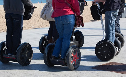 Spain, Barcelona, People on Segways, low section : Stock Photo