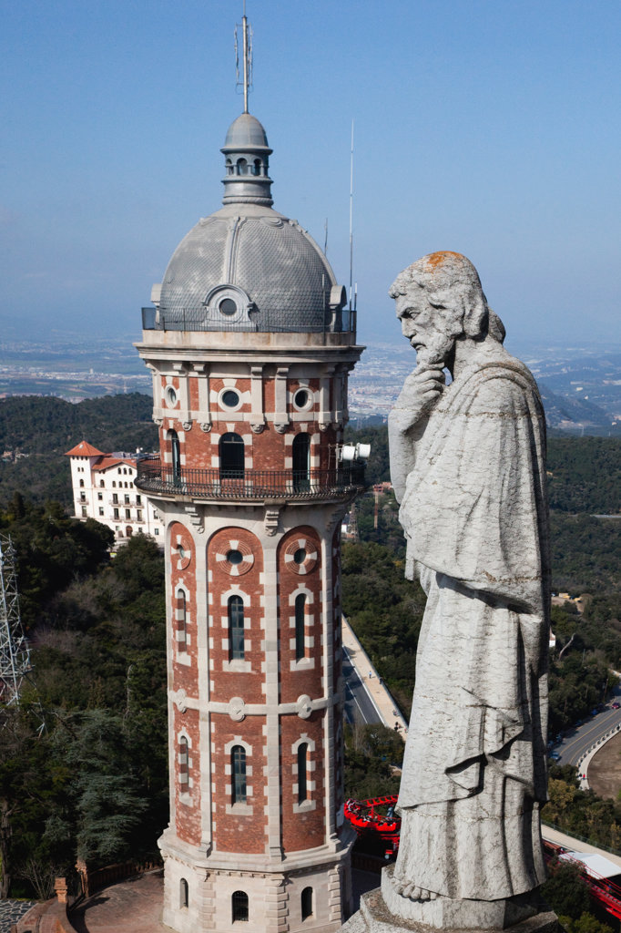 Stock Photo: 1323-1160 Spain, Barcelona, Tibidabo, Statue of sait and tower at Temple Expiatori del Sagrat Cor - The Church of the Sacred Heart