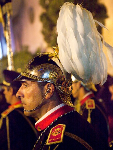 Stock Photo: 1323-1214 Spain, Seville, Side view of helmet member of marching band during Holy Week celebrations