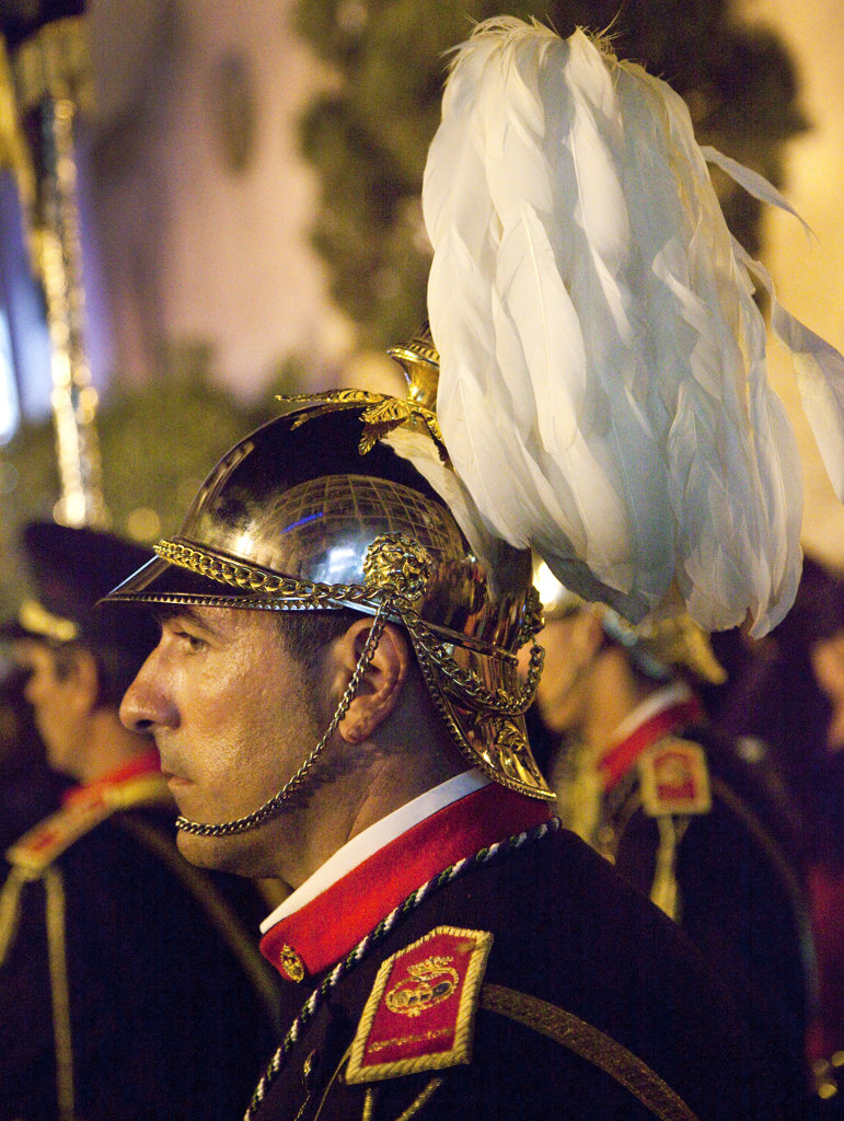 Spain, Seville, Side view of helmet member of marching band during Holy Week celebrations : Stock Photo