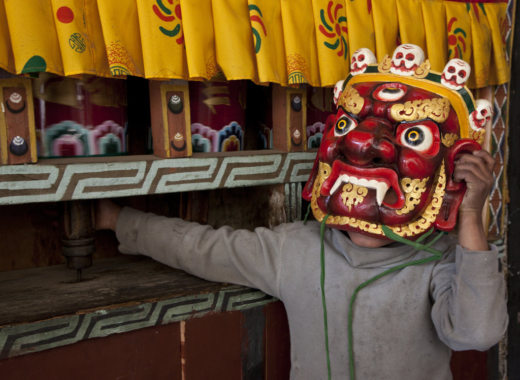Young monk wearing a Tshechu mask, Thimphu, Bhutan : Stock Photo