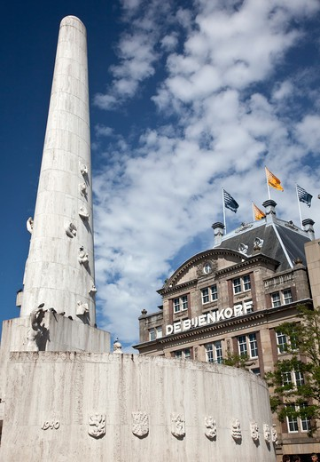 Stock Photo: 1323-1910 Low angle view of National Monument and De Bijenkorf in Dam Square, Amsterdam, Netherlands