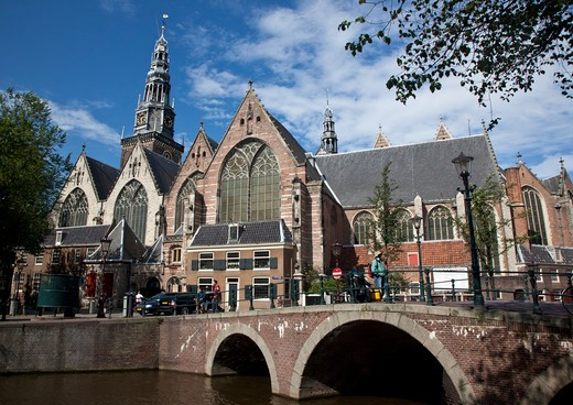 Bridge across canal in front of a church, Oude Kerk Church, Amsterdam, Netherlands : Stock Photo