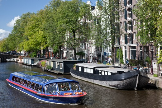 Scenic boat in the canal, Amsterdam, Netherlands : Stock Photo