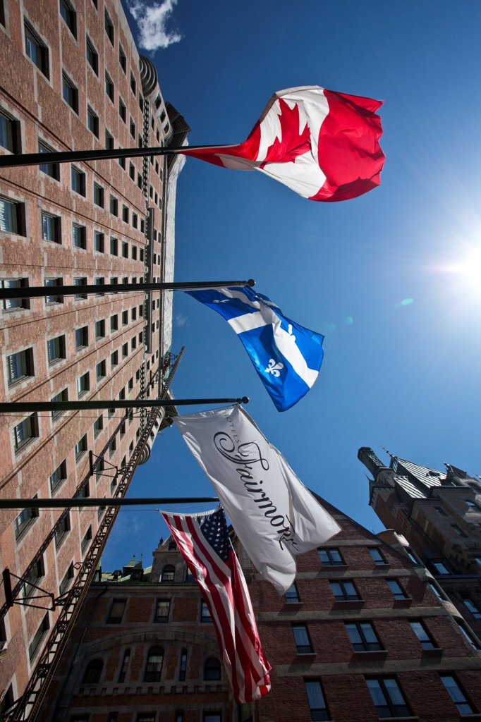 Flags outside a hotel, Chateau Frontenac, Quebec City, Quebec, Canada : Stock Photo