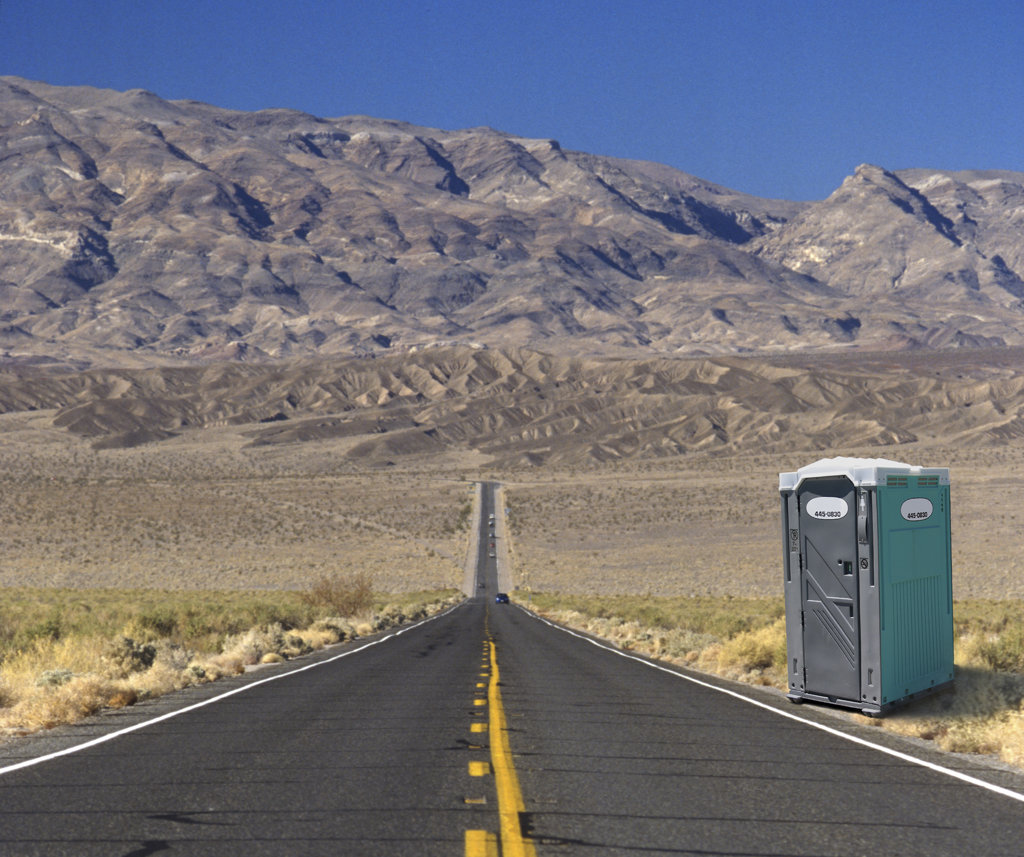Stock Photo: 1323-466 Portable toilet on the side of aroad
