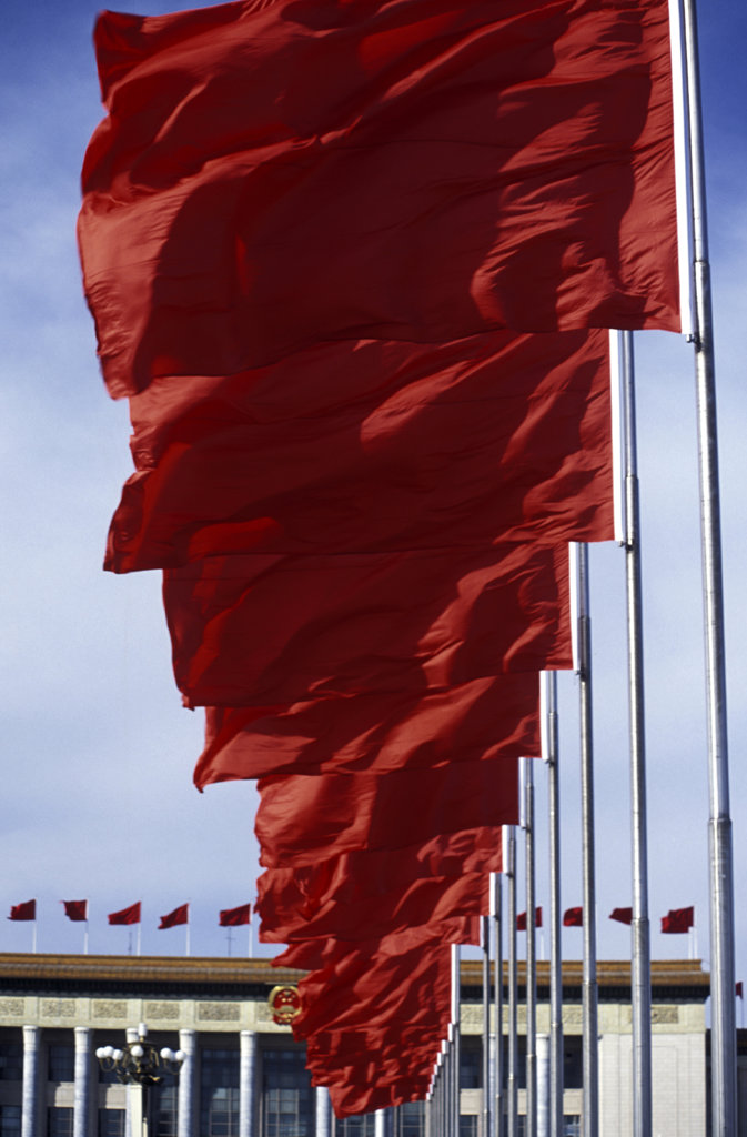 Stock Photo: 1323-669 Low angle view of Chinese flags in a row in front of a palace, Tiananmen Square, Beijing, China