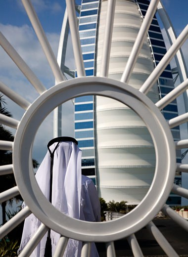 Stock Photo: 1323-744 Rear view of a man in front of a hotel, Burj Al Arab Hotel, Dubai, United Arab Emirates