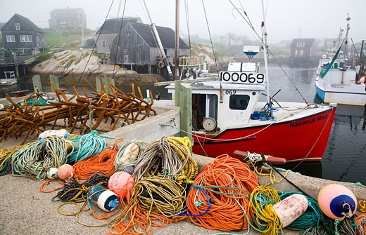 Fishing bobbers and ropes on a pier, Peggy's Cove, Nova Scotia, Canada : Stock Photo