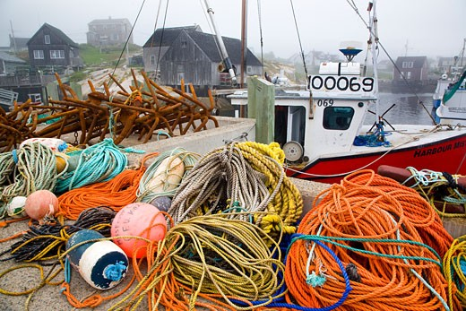 Stock Photo: 1323-832 Fishing bobbers and ropes on a pier, Peggy's Cove, Nova Scotia, Canada