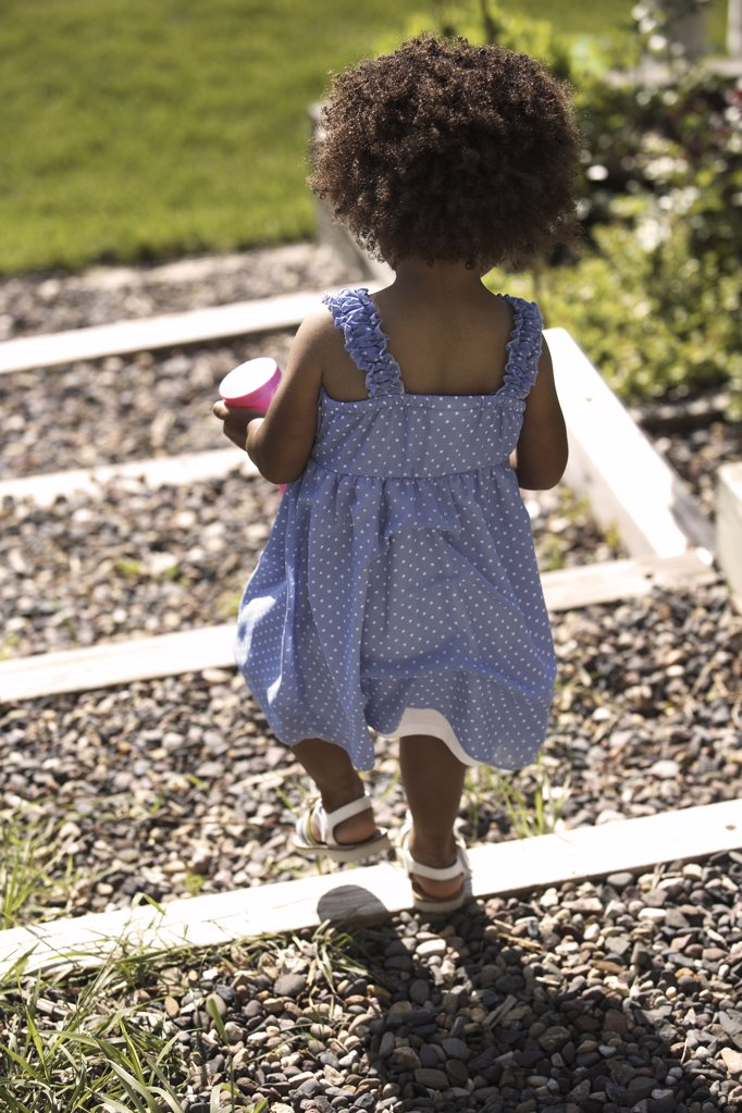 Stock Photo: 1329-1041 Rear view of a girl in a garden, St. Paul, Minnesota, USA