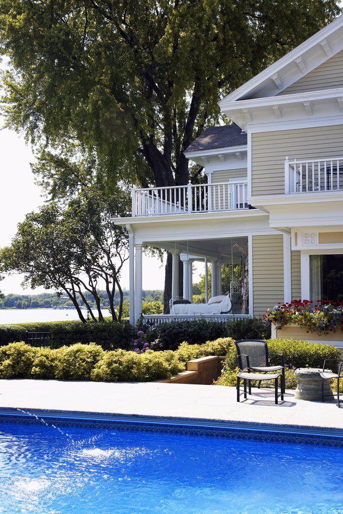 Stock Photo: 1329-1208 Mansion at the lakeside with a swimming pool