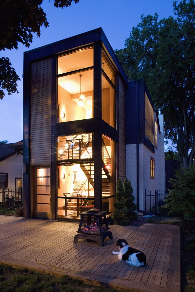 Modern home lit up at night : Stock Photo