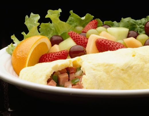 Stock Photo: 1329-127 Close-up of fruit with an omelet on a plate