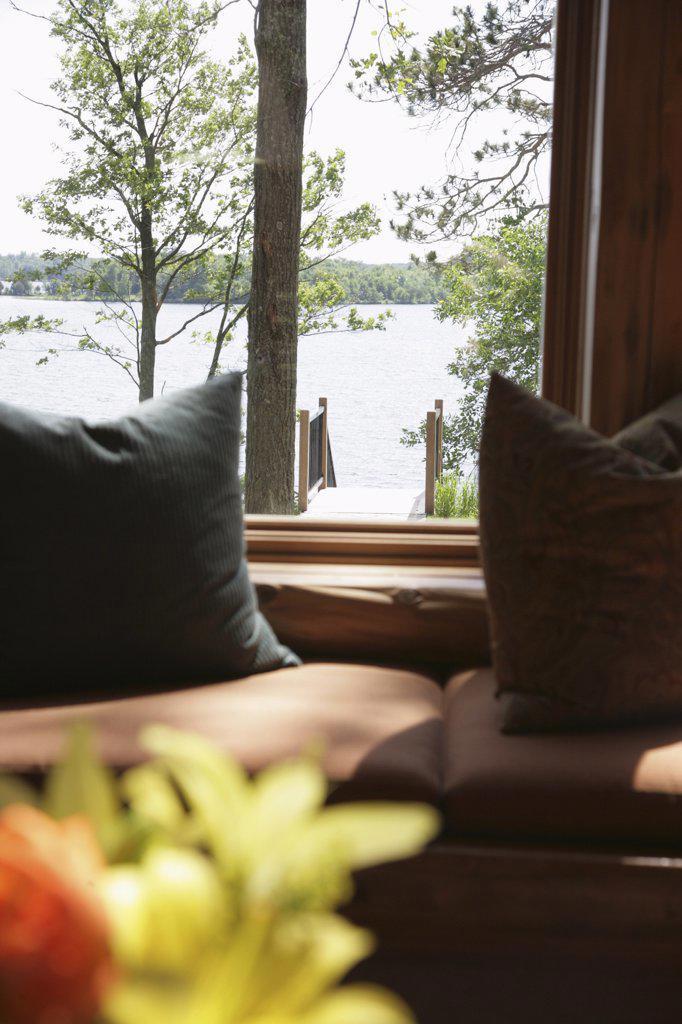 Lake viewed through a window : Stock Photo