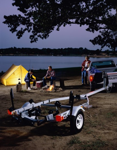 Stock Photo: 1329-186 Rear view of a vehicle trailer with a three generation family beside it