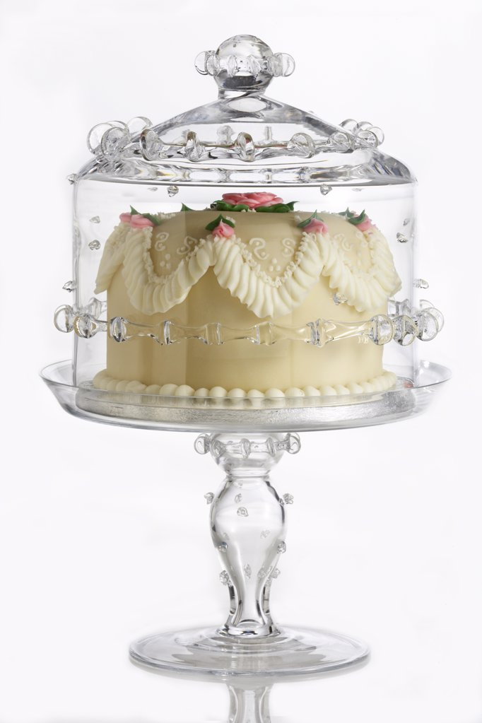 Decorated, fancy cake on ornate, glass cake plate : Stock Photo