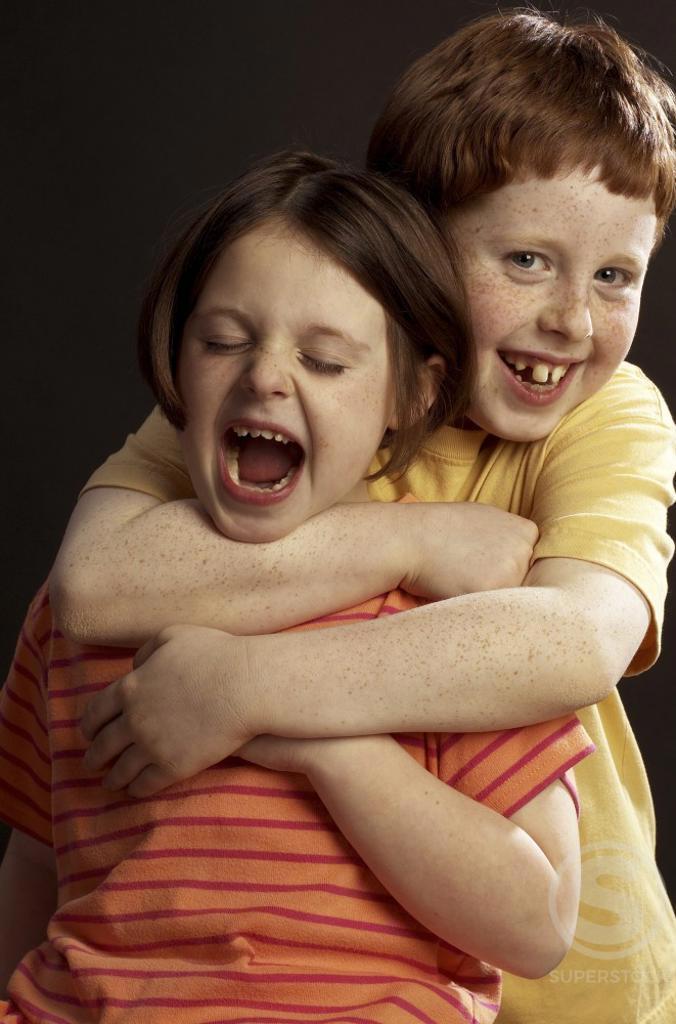 Portrait of a boy choking a girl : Stock Photo