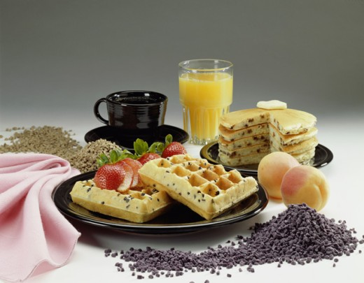 Plate of waffles and pancakes with a glass of orange juice : Stock Photo