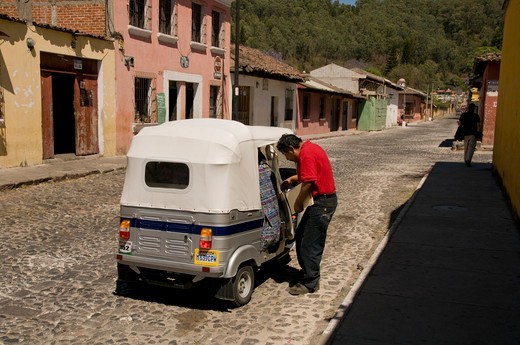 Stock Photo: 1336-1128 Man getting into rickshaw, Antigua, Guatemala