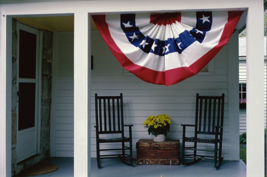 Stock Photo: 1336-901 Banner hanging on the porch of a house