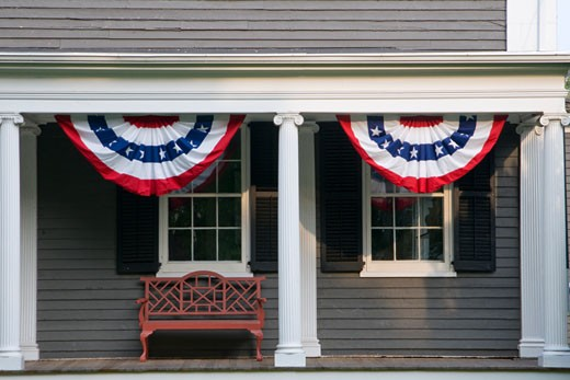 Porch decorated with American flags on 4th of July : Stock Photo