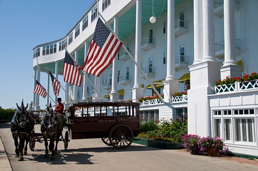 Horsedrawn carriage in front of a hotel, Grand Hotel, Mackinac Island, Michigan, USA : Stock Photo