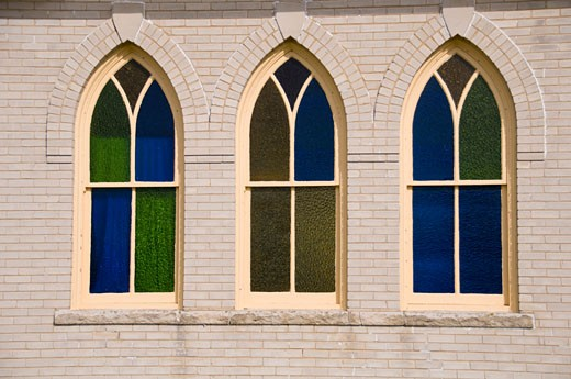 Stock Photo: 1336-977 Three stained glass windows of a church