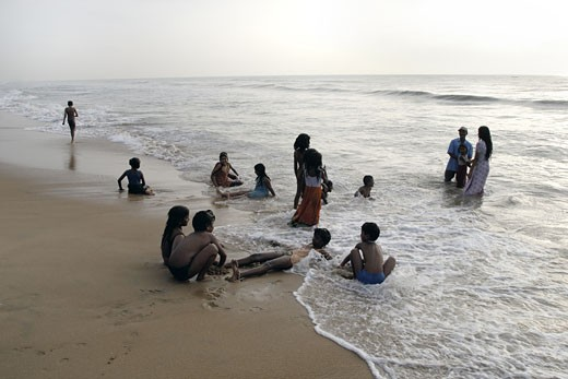 Tourists on the beach, Elliot's Beach, Besant Nagar, Chennai, Tamil Nadu, India : Stock Photo
