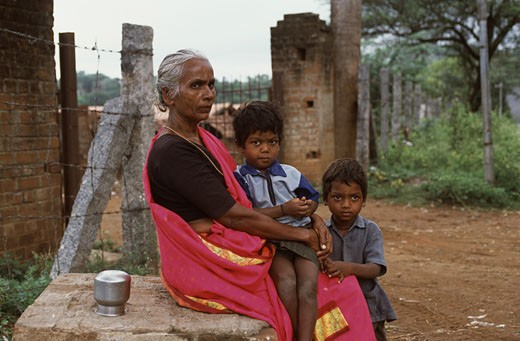 Stock Photo: 1340-967 Side profile of a mature woman with her two grandsons, Tamil Nadu, India