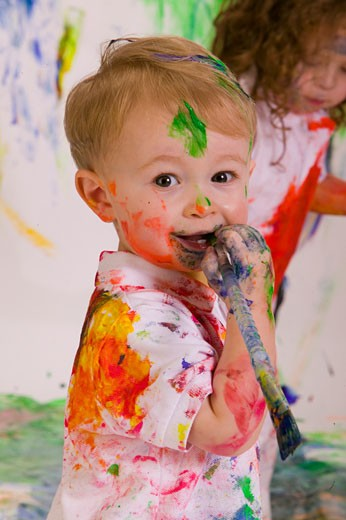Close-up of a boy and girl covered with paint : Stock Photo