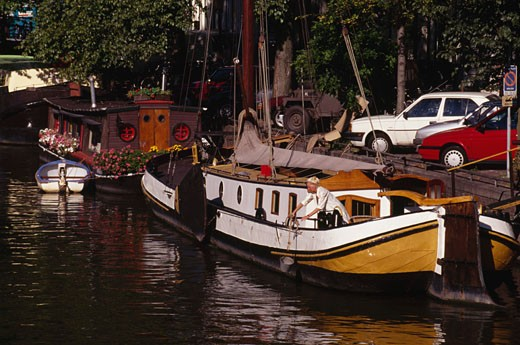 Boats docked in a canal, Brouwersgracht, Amsterdam, Netherlands : Stock Photo