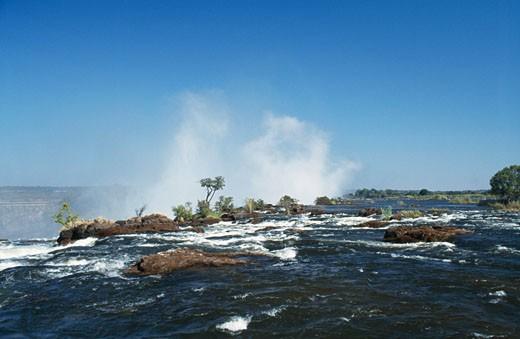 Stock Photo: 1344-1010 Water flowing through the rocks, Victoria Falls, Victoria Falls National Park, Zimbabwe