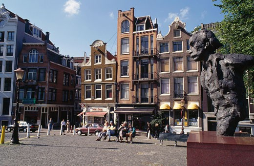 Townhouses in a town square, Singel, Amsterdam, Netherlands : Stock Photo