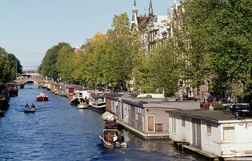 Tourists boating in a canal, Prinsengracht, Amsterdam, Netherlands : Stock Photo