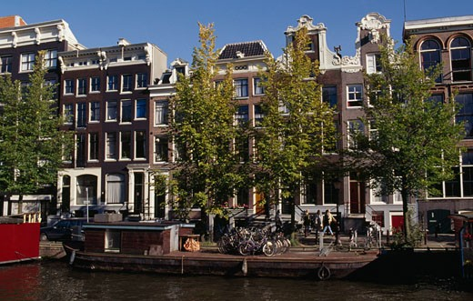 Facade of townhouses on the waterfront, Prinsengracht, Amsterdam, Netherlands : Stock Photo